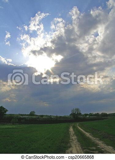 Sun rays breaking through the cloud - csp20665868