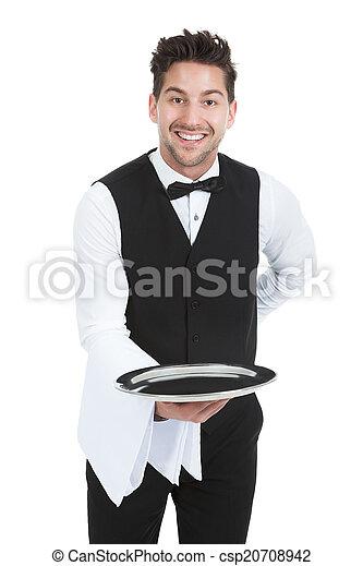 photo de servir serveur jeune tenue sourire plateau vide csp20708942 recherchez des. Black Bedroom Furniture Sets. Home Design Ideas