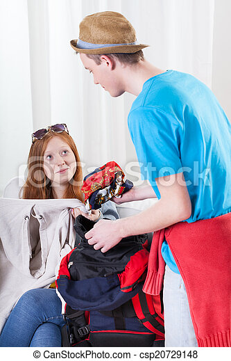 Girl and boy packing a backpack