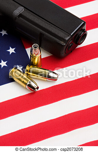 gun and bullets on flag - csp2073208