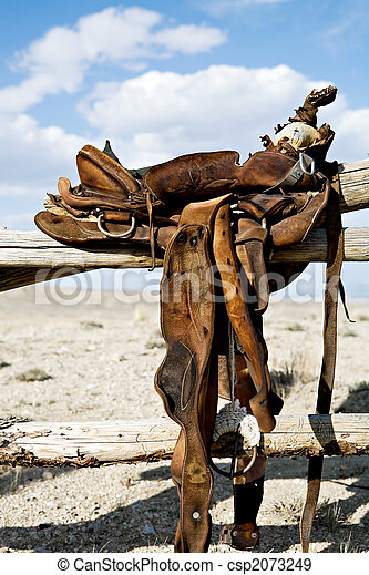 saddle on rural fence - csp2073249
