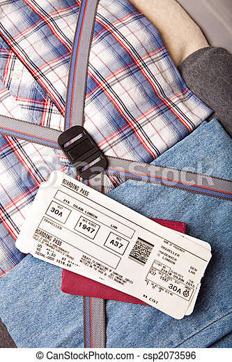 boarding pass passport on suitcase - csp2073596