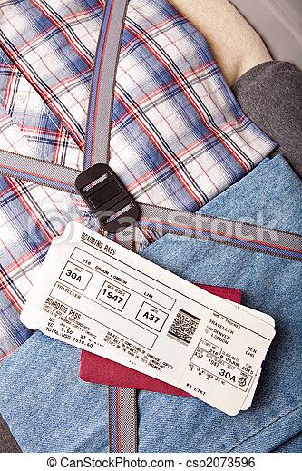 boarding pass passport on suitcase - csp2073596