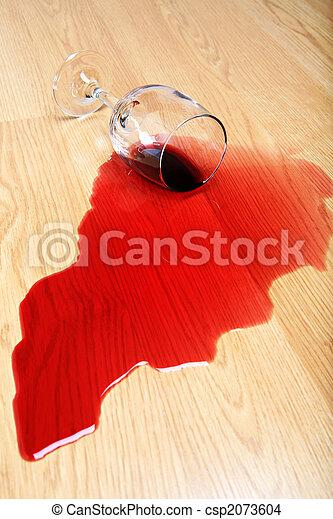 wine spill on hardwood floor - csp2073604