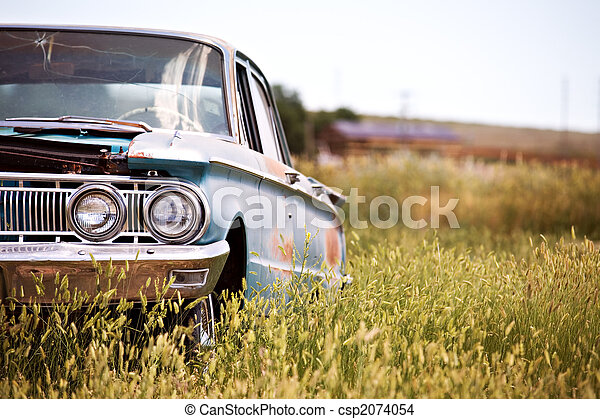 abandoned car in field - csp2074054