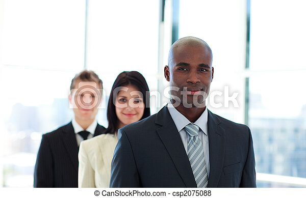 African businessman leading his team - csp2075088