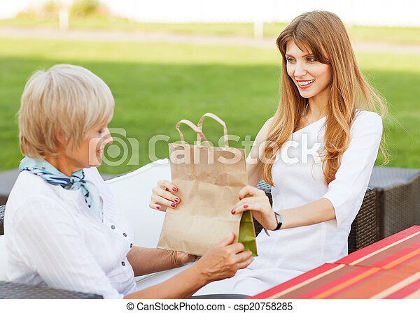 Daughter gives mother a gift - csp20758285