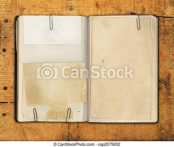 Blank Vintage Book on Weathered Wood  - csp2075932