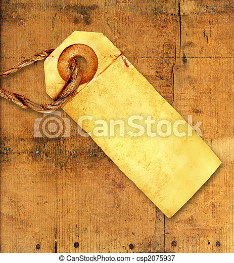 Old Tag on Weathered Wood - csp2075937