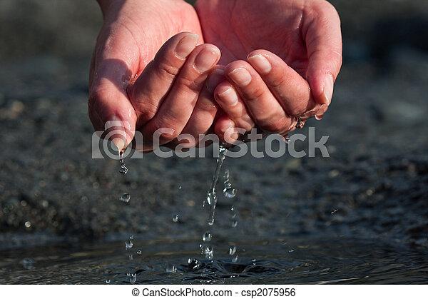 Hands are scooping water - csp2075956