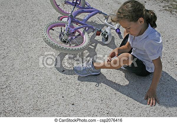 Girl falling off bike - csp2076416