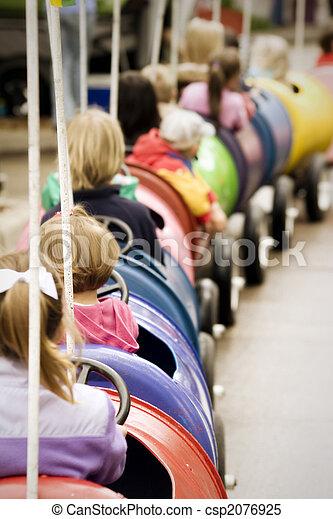 Kids on amusement park train ride - csp2076925