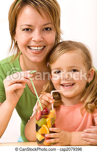 Woman and little girl having a fruity refreshment - csp2079396