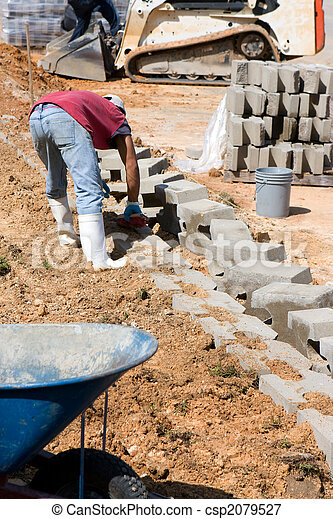 Construction Worker Laying Blocks - csp2079527