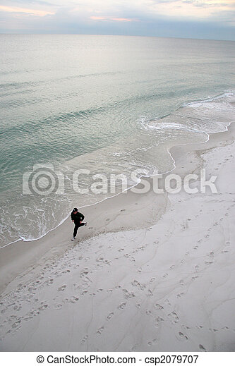 Man Running By The Seashore - csp2079707