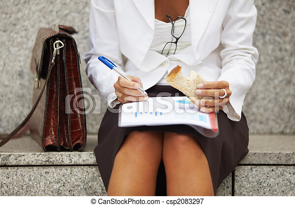 businesswoman eating sandwich  - csp2083297