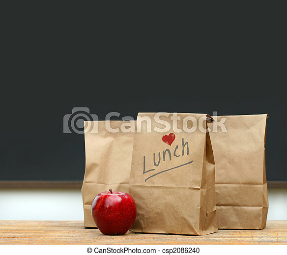 Lunch bags with  apple on school desk - csp2086240