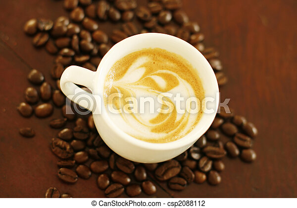 Top view of piccolo latte with a coffee art design. - csp2088112