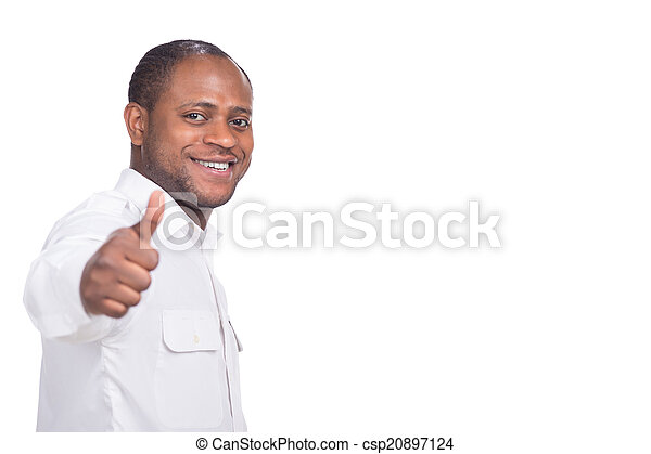 handsome black man shows thumbs up. person standing on white background smiling