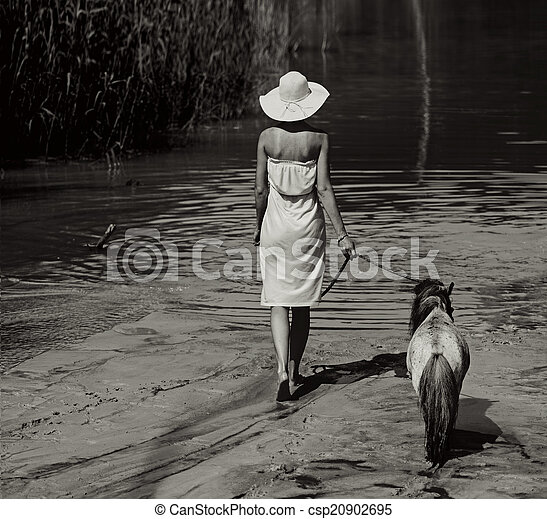 Photo of the woman walking with pony