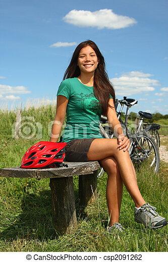 Woman resting from biking - csp2091262