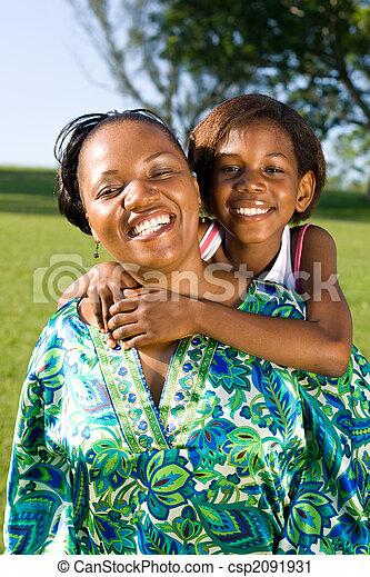 joyful african mother and daughter