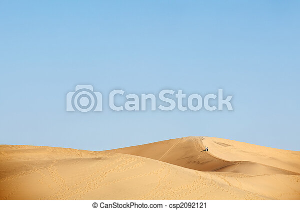 two people walking in desert dunes - csp2092121