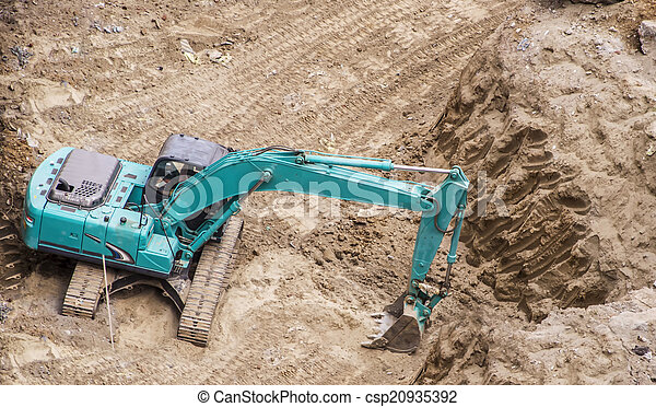 Heavy earth mover digging
