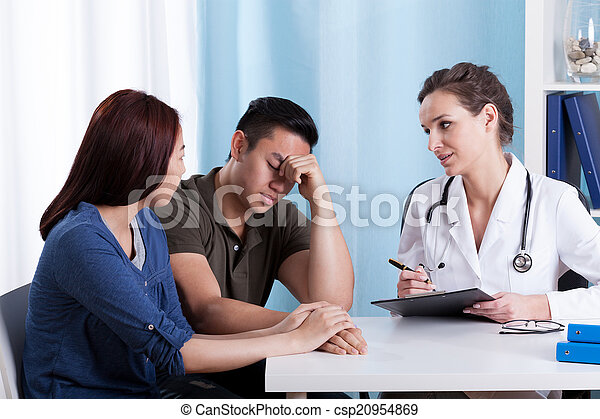 Female doctor talking with her patients
