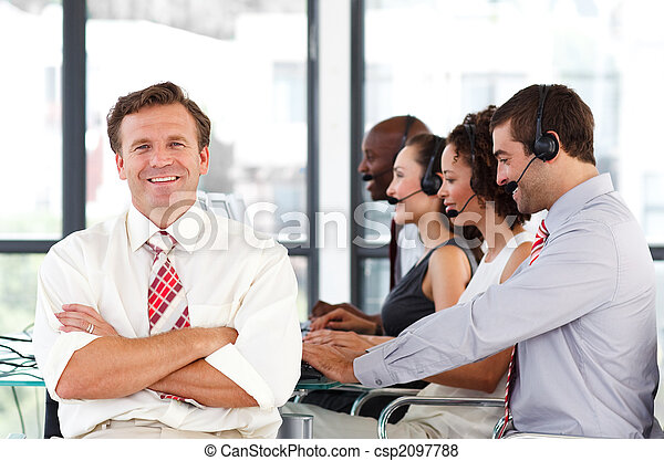 Smiling businessman in a call center - csp2097788