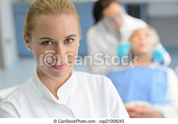 Dental assistant closeup dentist checkup patient - csp21008243