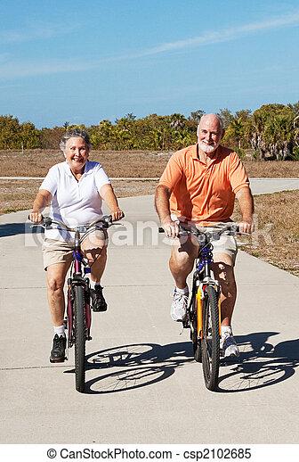 Active Retired Seniors on Bikes - csp2102685