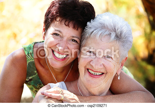 Beautiful senior mother and daughter smiling - csp2109271