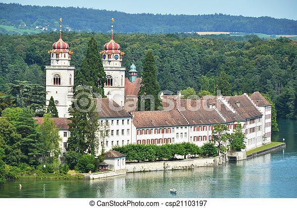 Rheinau Abbey across Rhine river, Switzerland - csp21103197