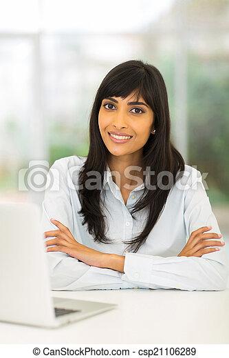 indian businesswoman relaxing in office - csp21106289