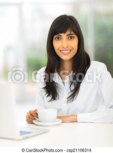 indian businesswoman drinking coffee