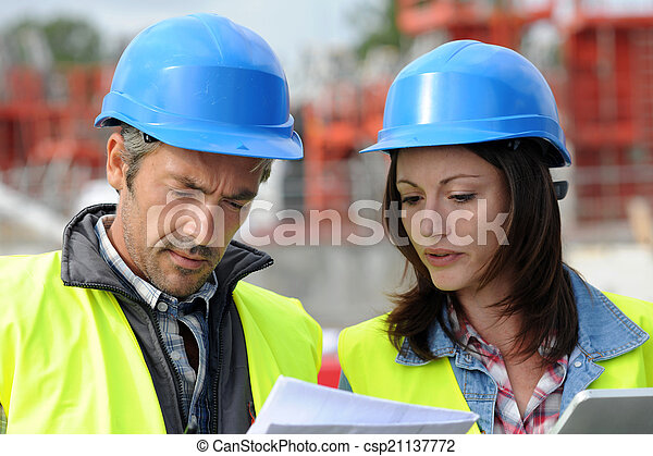 Closeup of engineers with blue helmet on building site