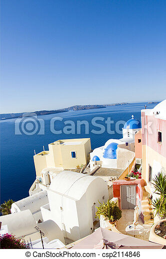 incredible santorini with cobble stone street flowers and classic whitewashed cyclades architecture with blue dome greek church in oia on the famous island of santorini thira in greece fish eye view - csp2114846