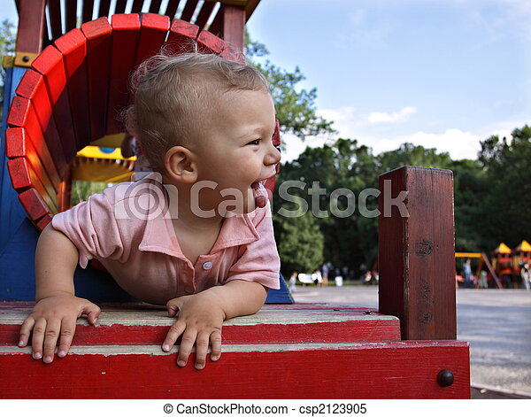 Happy kid in a playground tunnel - csp2123905