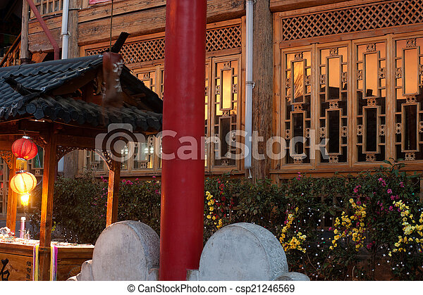 Evening Sun reflection on glass with traditional wooden wall by