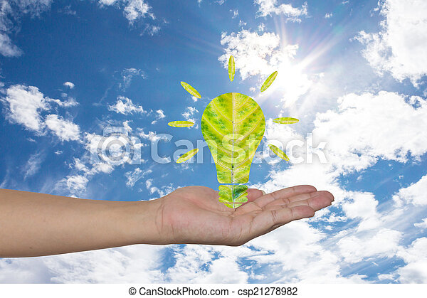 Light bulb made of green leaf on woman hands Green eco energy c