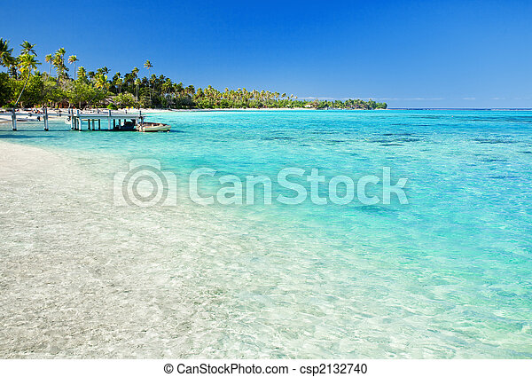 Little jetty on tropical beach with amazing water - csp2132740