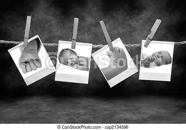Black and White Photos Hanging on a Rope - csp2134596