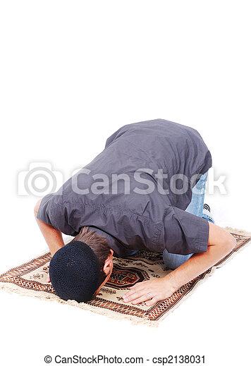 Muslim man is praying on traditional way - csp2138031