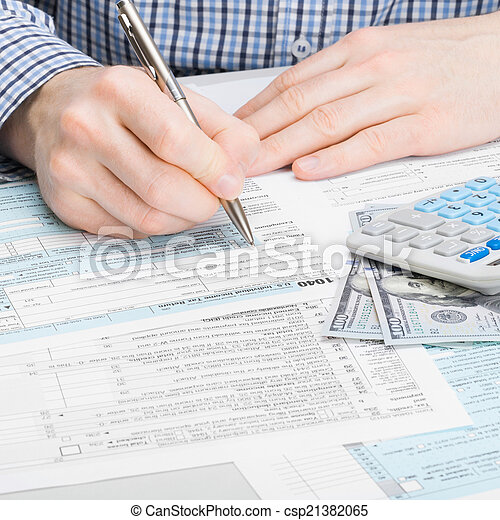 Male filling out 1040 USA Tax Form - studio shoot - 1 to 1 ratio