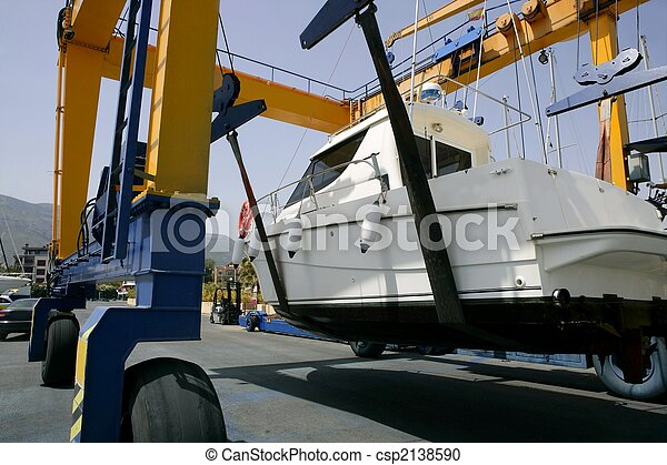 Dock crane elevating a fishing boat - csp2138590