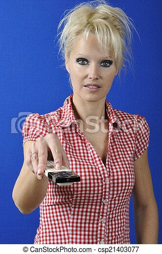 Womanl with TV remote control
