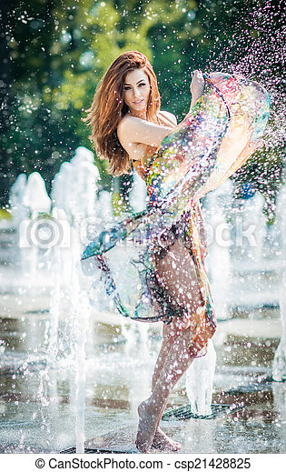 Pretty girl playing with water