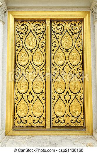 Golden door of church - csp21438168
