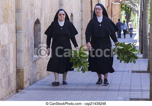 MADRID, SPAIN - APRIL 4:Nuns walking down the street prepared the